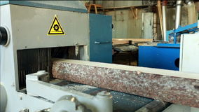 Sawmill. View of log moves on machine conveyor stock footage