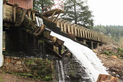 Sawmill. Water falling from old sawmill with wooden water channel in Sumava National Park, Czech Republic Royalty Free Stock Photography