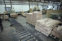 Sawmill wood industry. Interior of a sawmill and wood stack Stock Images