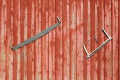 Saws on a door Royalty Free Stock Photography