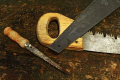 Saws. On old wood work bench Royalty Free Stock Photography
