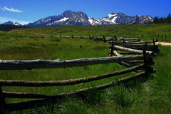 Sawtooth Fenceline. Rustic fence at the foot of the Sawtooth Range, Stanley Idaho Stock Photography