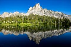 Sawtooth mountains reflected in Alice Lake, Idaho Royalty Free Stock Photos