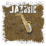 Sax jazz is a live music on an old brick wall. Musical background saxophone in the doorway of an old brick wall and the words jazz is a live music Stock Photos