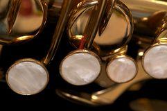 Sax keys. A brass Saxophone's  with valve and key details Stock Photography