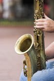 Sax on knees. Sax player in Boulder, Colorado holding his sax on his knees Stock Photography