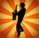 Sax musician silhouette on the vintage background Royalty Free Stock Images