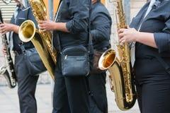 sax musician walking in the street Stock Photos