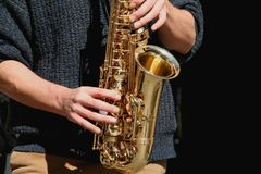 Sax player. Musical Instruments royalty free stock image