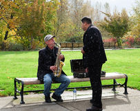 Sax player performs in Corvallis park Stock Photo