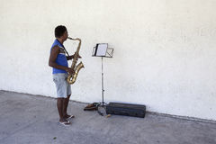 Sax player. Practicing in Havana. Because huge shortage of any kind ih housing it is normal to see serious musician practicing outdoor Stock Images