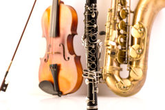 Sax tenor saxophone violin and clarinet in white Stock Images
