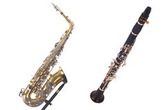 Saxaphone and  clarinet. Isolated on white background Royalty Free Stock Photography