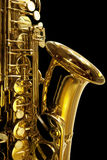 Saxaphone Detail. Detail of alto saxaphone, over black background Royalty Free Stock Photography