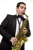 Saxaphone Player Playing. A saxophone player in formal concert dress isolated on white Stock Photos