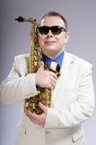 Saxofón del amigo Imágenes de archivo libres de regalías
