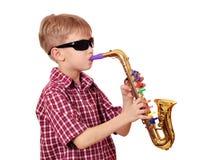 Saxofón del juego del muchacho Foto de archivo libre de regalías