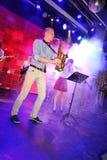 Saxofón a solas Genios jovenes del jazz en el club Olympia Imagen de archivo libre de regalías