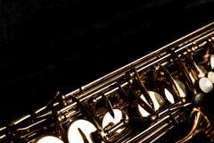 Saxofon i den svarta asken Arkivfoton
