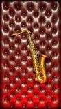 Saxofone com parede de couro Foto de Stock