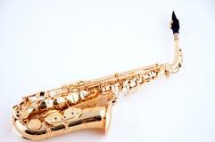Saxofone do ouro isolado no branco Imagem de Stock