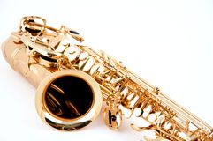 Saxofone do ouro isolado no branco Foto de Stock