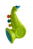 Saxofone para crianças, plástico em um fundo isolado Foto de Stock