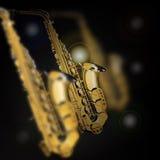 Saxofones na focalização diferente ilustração stock