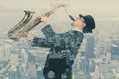 Saxofonist Double Exposure arkivbilder