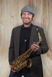Saxofonist met hoed op een onderbreking Royalty-vrije Stock Afbeelding