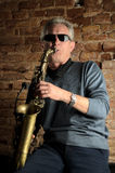 Saxofonspelare arkivfoto