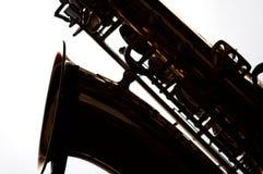 Saxofoon in Silhouet op Wit Stock Afbeeldingen