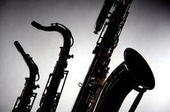 Saxofoons die in Silhouet worden geïsoleerde Royalty-vrije Stock Afbeelding