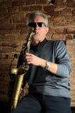 Saxofoonspeler stock foto