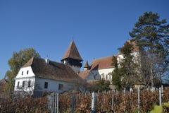 Saxon ha fortificato la chiesa in Bazna, la Transilvania Fotografia Stock