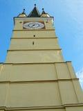 Saxon tower clock closeup of clock from bottom in Medias, Romani. Medieval German Lutheran church of Medias, detail of the clock tower, Medias, Romania. closeup Stock Photos