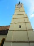 Saxon tower clock closeup of clock from bottom in Medias, Romani. Medieval German Lutheran church of Medias, detail of the clock tower, Medias, Romania. closeup Royalty Free Stock Photo