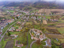 Saxon walled church in Transylvania, Romania. Alma Vii village. Aerial view from a drone Stock Photos