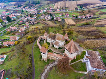 Saxon walled church in Transylvania, Romania. Alma Vii village. Aerial view from a drone Royalty Free Stock Photos