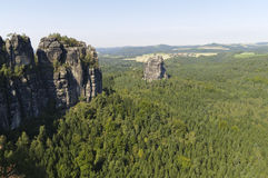 Saxony Switzerland. View from the Schrammsteine, of the  table mountain Falkenstein, in Elbsandsteingebirge, Saxony Switzerland Royalty Free Stock Image