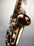 Saxophone. Closeup against neutral background Stock Image