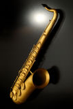 Saxophone. Scale model saxophone on black stock images