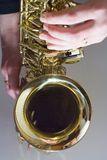 Saxophone. Playing the alto saxophone Stock Photography