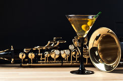 Saxophone And Martini With Green Olives Royalty Free Stock Photography
