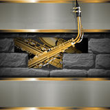 Saxophone on a background of stones Royalty Free Stock Photo