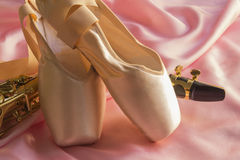 Saxophone and Ballet shoes Royalty Free Stock Images