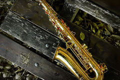 Saxophone on bench Royalty Free Stock Photography