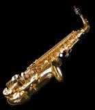 Saxophone on black background. Shiny golden saxophone on black background Royalty Free Stock Photos