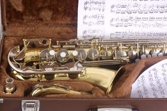 Saxophone and case Stock Images