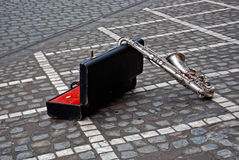 Saxophone with case on the street Stock Photography
